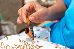 Painting watercolor on the fabric to make Batik. Stock Photography
