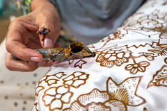 Painting watercolor on the fabric to make Batik. Royalty Free Stock Photo