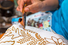 Painting watercolor on the fabric to make Batik Royalty Free Stock Photo
