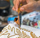 Painting watercolor on the fabric to make batik. Royalty Free Stock Image