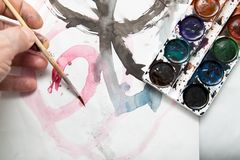 Painting watercolor paint on white paper. Photos in the studio Royalty Free Stock Image