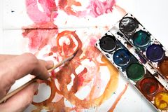 Painting watercolor paint on white paper. Photos in the studio Stock Image