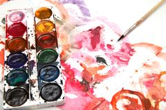 Painting watercolor paint on white paper. Photos in the studio Stock Photography