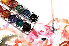 Painting watercolor paint on white paper. Photos in the studio Stock Photos