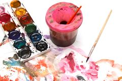 Painting watercolor paint on white paper. Photos in the studio Royalty Free Stock Photos