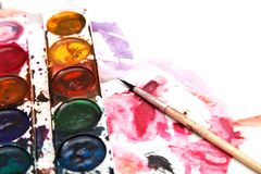 Painting watercolor paint on white paper. Photos in the studio Royalty Free Stock Photography