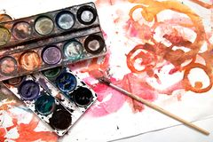 Painting watercolor paint on white paper. Photos in the studio Stock Images