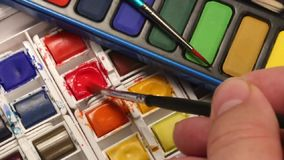Painting - Watercolor Paints. Painting using a watercolor paint set stock footage