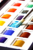 Painting with watercolours Stock Images