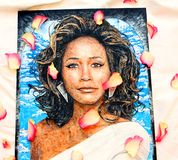 Painting of Whitney Houston. Hand painting of the late great singer Whitney Houston.Painted on a canvas using acrylic paint with rose petals place over the art Stock Images
