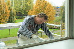 Painting a window-frame Stock Photos