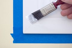 Painting Window Trim. Painting a window trim or molding Royalty Free Stock Images