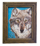 Painting of a Wolf by artist with Frame. Painting of a wild wolf with wooden frame royalty free stock image