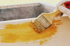 Painting wood furniture Stock Photo