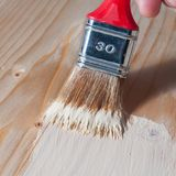 Painting wood whit a brush. Painting on a wood surface with a brush Royalty Free Stock Photography