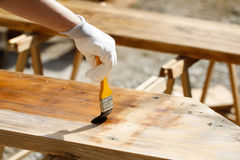 Painting wood with wood protection paint Royalty Free Stock Photos
