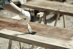 Painting wood with wood protection paint Royalty Free Stock Image
