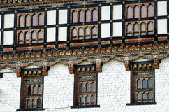 Painting and wood work of windows at Tashi Cho Dzong, Thimphu, Bhutan Royalty Free Stock Photo