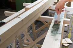 Painting a wooden beam Royalty Free Stock Photo