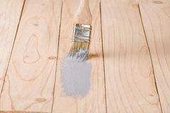 Painting wooden board paint brush gray color Royalty Free Stock Photography
