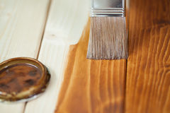 Painting wooden boards. During renovation at home Royalty Free Stock Photo