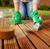 Painting wooden deck Stock Images
