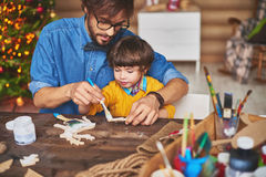 Painting wooden figures Stock Photo