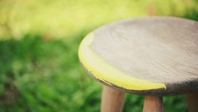 Painting wooden furniture with a brush stock video