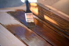 Painting wooden furniture Royalty Free Stock Photo