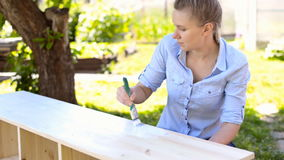 Painting wooden furniture. stock footage