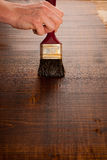 Painting wooden table for protection and wood maintenance oil-wa Stock Photo