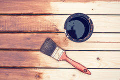 Painting wooden table using paintbrush Stock Photography