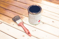 Painting wooden table using paintbrush Royalty Free Stock Photo