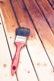 Painting wooden table using paintbrush Stock Image