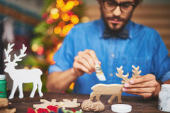 Painting wooden toy deer Royalty Free Stock Photo
