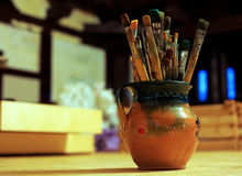 Painting workshop. A lot of brushes in the studio of the artist Stock Photo