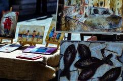 Paintings on display. Oil paintings on display in street art exhibition Stock Photo
