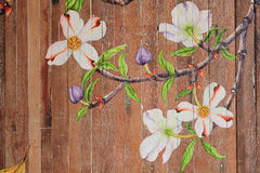Paintings of flowers on wood floors. Painting flowers Camille along the wooden floor stock photos