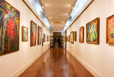 Paintings hanging in a Museum Hallway royalty free stock photo