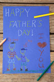 Paintings and happy fathers day message on paper Royalty Free Stock Photography