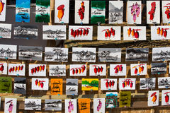 Paintings of monks and Inle lake are sold as souvenirs in market. Myanmar, Burma Stock Image