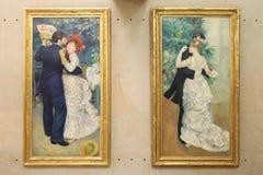 Paintings by Pierre Auguste Renoir `Dance in the city`and `Dance in the village.` Paris. 01.10.2011. Paintings by Pierre Auguste Renoir `Dance in the city`and ` stock photos