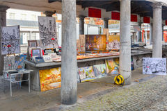 Paintings for sale on the fish market Vismarkt in Royalty Free Stock Image