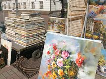 Paintings for sale in Old Arbat street, Moscow. Old Arbat street exists in Moscow since 16th century. It`s famous among tourists for its street artists and Stock Image