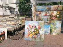 Paintings for sale in Old Arbat street, Moscow. Old Arbat street exists in Moscow since 16th century. It`s famous among tourists for its street artists and Stock Images