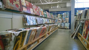 Paintings on shelves selling at store Royalty Free Stock Photography