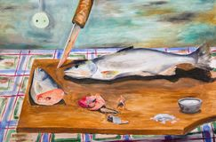 Frozen fish on a cutting board. The paintings. A whole salmon and cut into pieces on the table Royalty Free Stock Images