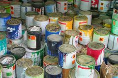 Paints. A collection of old paint cans Stock Photos