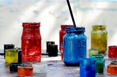 Paints. Jars with colourful paints. Closeup Stock Photos