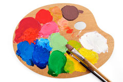 Paints. Paintbrushes on the palette with bright paints Stock Photo